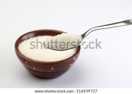 wooden Bowl of sugar with metal spoon - stock photo