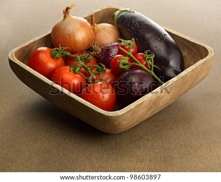 Wooden bowl with  fresh vegetables - stock photo