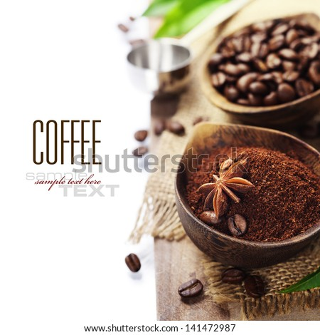 Wooden Bowls with coffee beans and ground coffee over white (with sample text) - stock photo