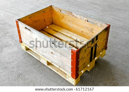 Wooden box at standard euro pallet in warehouse - stock photo