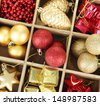 Wooden box filled with christmas decorations, isolated on white - stock photo