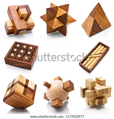 Wooden Brain Teaser on White Background - stock photo