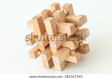 Wooden Brain Teaser on White Background. Unique Perspectives - stock photo