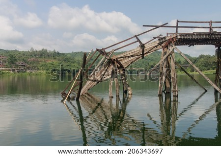 Wooden bridge collapses By strong currents - stock photo