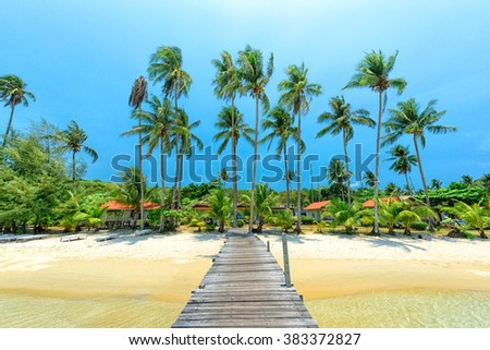 Wooden bridge for entry to the beautiful island - stock photo