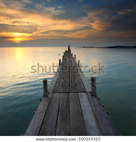 Wooden bridge in the sunset on the Ao Ngam Kho at Koh Kood, Trat in Thailand - stock photo