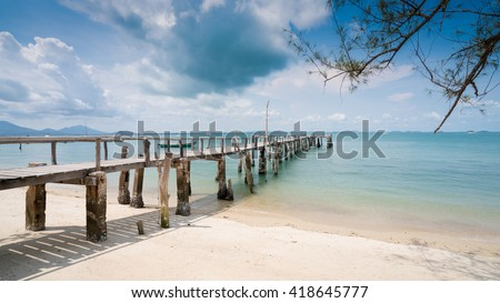 Wooden bridge into the sea.One of the most beautiful and most popular beaches on Koh Samet. Crystal Sand Beach at Samet Island thailand - stock photo