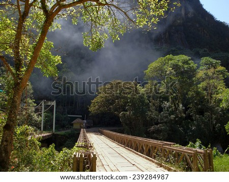 wooden bridge near Machu Picchu, a ancient Inka city in the Andes located in Peru (South America) - stock photo