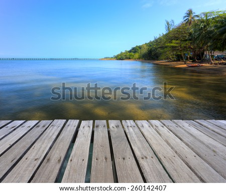 Wooden bridge over the seascape, tropical view in Thailand. - stock photo