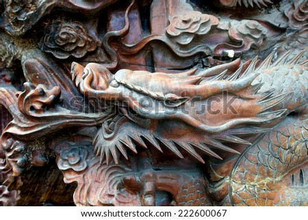 Wooden brown carved Dragon in Guilin China - stock photo