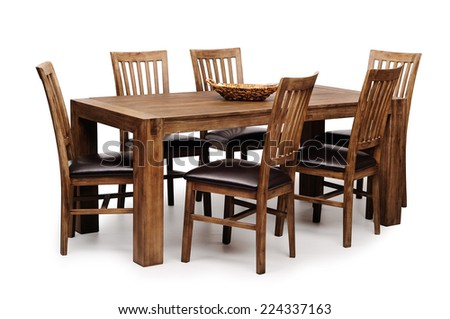 Wooden brown table and six chairs shot on white background - stock photo