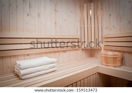wooden  bucket and white towels in a sauna  - stock photo