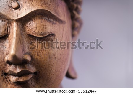 Wooden Buddha Face - stock photo