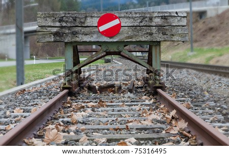 wooden buffer stop with red stop sign ending rail tracks concept for limit, limitation restriction boundary, prohibited, end , border - stock photo