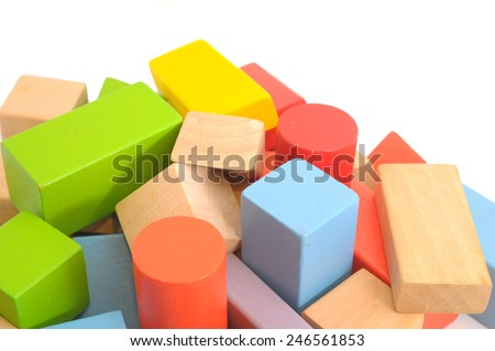 Wooden building block on white background. - stock photo