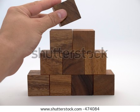 Wooden building blocks in the shape of a triangle - stock photo