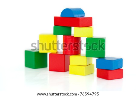 Wooden building blocks on a white background - stock photo