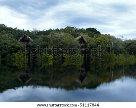 Wooden bungalows, Amazon river, Brazil - stock photo