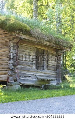 Wooden cabins with turf roof at a campsite in Sweden - stock photo