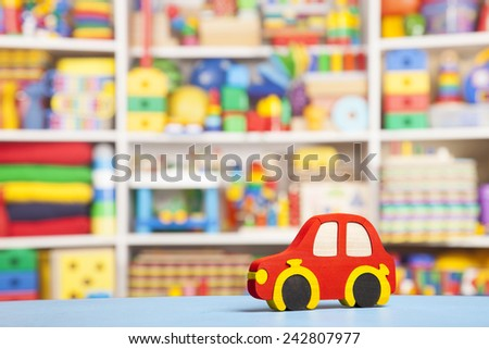 wooden car in room for children - stock photo
