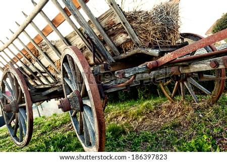 wooden cart in rural background - stock photo