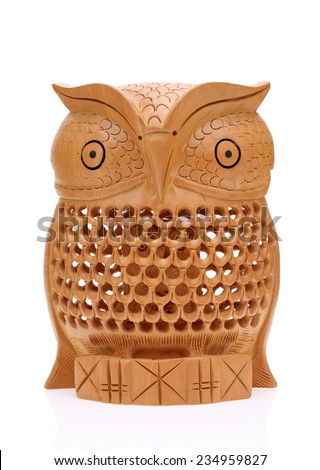 Wooden carved owl isolated on white background  - stock photo