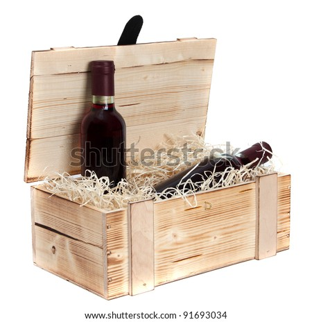 wooden case with two bottles of red wine - stock photo