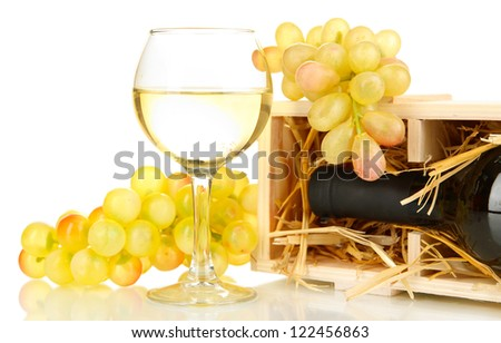 Wooden case with wine bottle, barrel, wineglass and grape isolated on white - stock photo