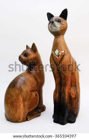 Wooden cat in elegant posture - stock photo