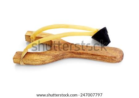 Wooden catapult slingshot isolated on white background - stock photo