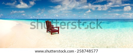 Wooden chair standing sea beach invitation rest deserted island alone wide panoramic view ocean - stock photo