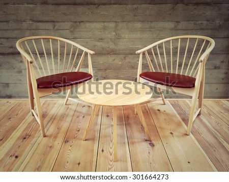 Wooden chairs and coffee table in a room with modern design. - stock photo