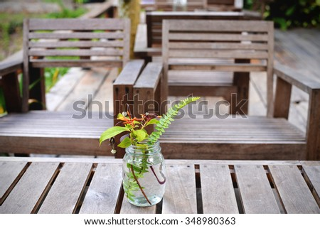 Wooden chairs and coffee table in the garden. Living area in vintage style - stock photo