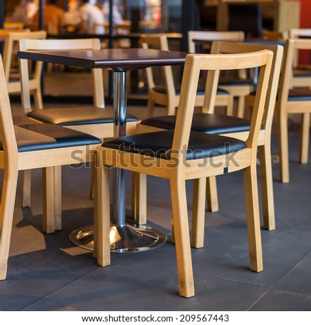 wooden chairs and wooden table  - stock photo