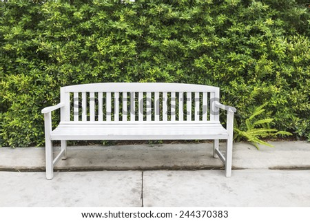 wooden chairs in the garden - stock photo