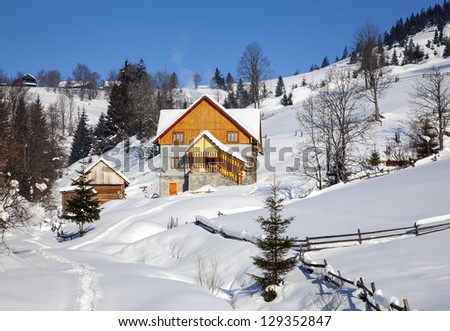 Wooden chalet in winter Carpathian mountains - stock photo