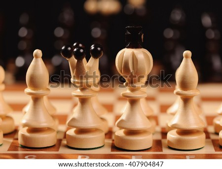 wooden chess pieces with chess desk - stock photo