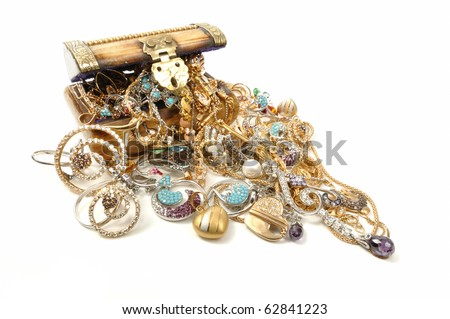 Wooden chest full of gold jewelry, isolated on white - stock photo