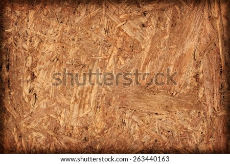 Wooden chipboard reverse side, rough, extra coarse, vignette surface texture detail. - stock photo