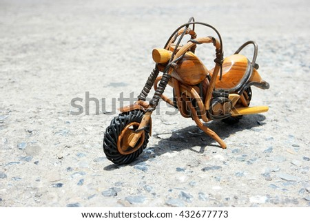 wooden chopper or motorbike or motorcycle place on rough ground and ready dream to travel or adventure to anywhere on the earth - stock photo