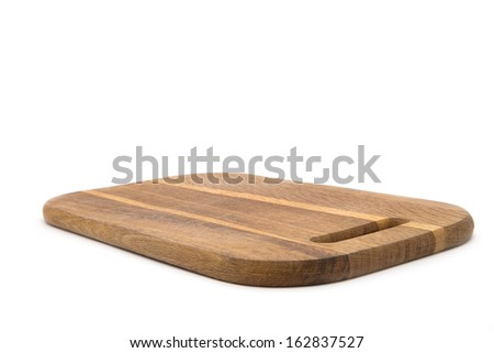 Wooden chopping board isolated on white background - stock photo