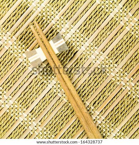 wooden chopsticks on a Bamboo mat - stock photo