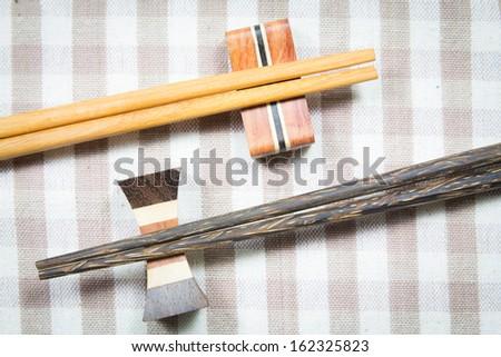 wooden chopsticks on a fabric - stock photo