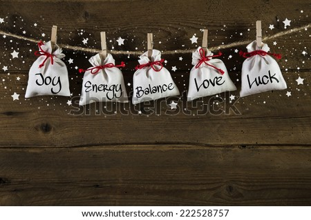 Wooden christmas background: greeting card with presents and text. - stock photo
