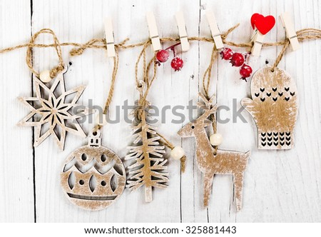 Wooden christmas decoration hanging over wooden background - stock photo