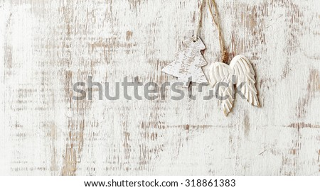 Wooden Christmas tree decorations in white - stock photo