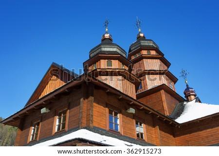 Wooden church in Ivano-Frankivsk on the way to Bukovel, Ukraine - stock photo