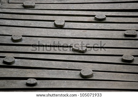 Wooden climbing wall on a adventure playground - stock photo