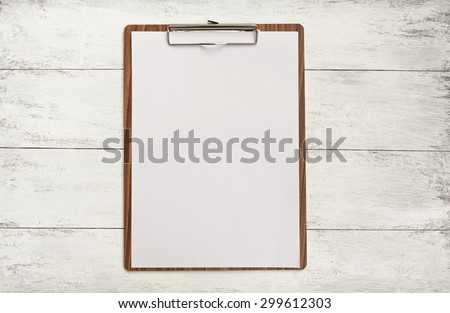 Wooden clipboard on wood background - stock photo