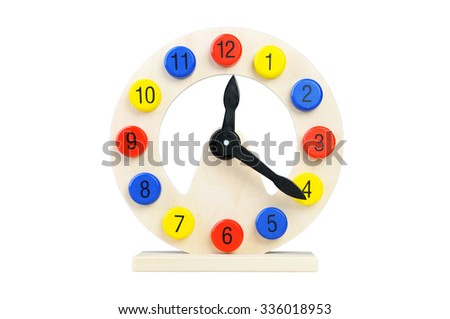 Wooden clock on a white background. Toy for Children - stock photo